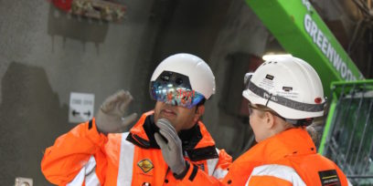 Soluis and Crossrail builders in hard hats on site
